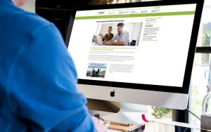 Internal page of Healix website on a computer with arm of person visible