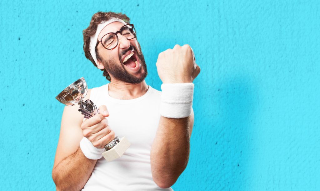 Man celebrating a win holding a trophy, representing good social content