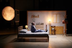 Still from benenden tv ad of man sitting on bed in pain