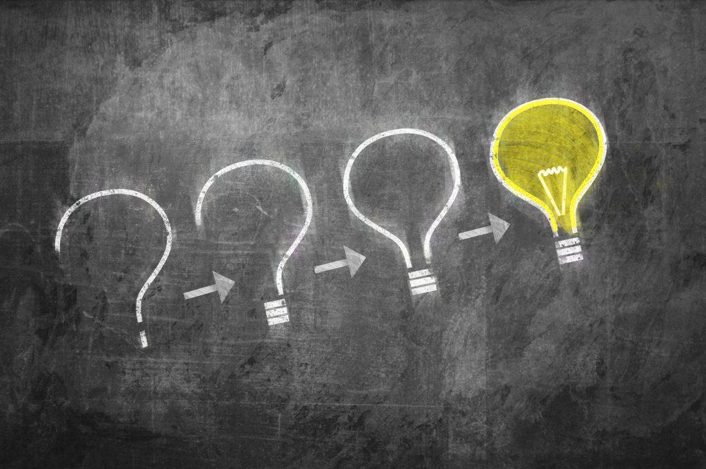 4 chalk drawn lightbulbs representing brand strategy development